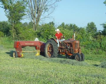 case tractor pulling new holland baler