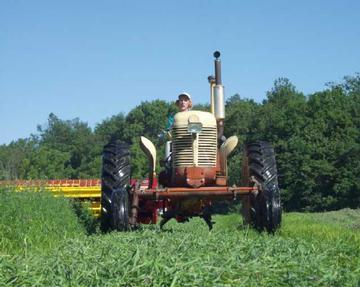 case tractor pulling newholland mower