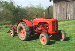 case tractor in front of barn