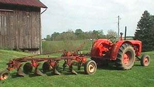 case tractor with 4 bottom plow