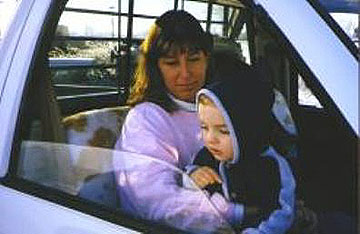 woman and baby sitting in truck
