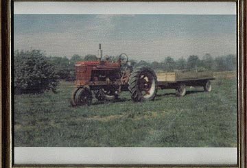 old shot of farmall pulling four wheel wagon