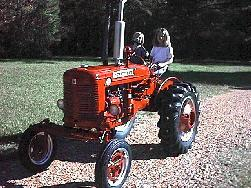 boy driving tractor