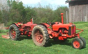 two case tractors on grass