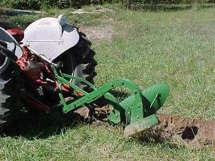 tractor with plow at steep angle