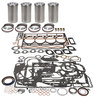 photo of This Engine Kit is for 203 CID 4 Cylinder Diesel Engine, 3.6 inch standard bore, injectors at angle in cylinder head. For engine serial number 2939036 to 29C108. Basic Engine Kit. Contains CAST sleeves, .150 inch flange thickness, pistons and rings, pins and retainers, pin bushing, gasket sets, and crankshaft seals, rear seal is a two piece rope type. This kit contains 5 ring pistons with combustion chamber. For 300, 302, 304, 3165, 356, MF165, MF65. Bearings and thrust washers must be ordered separately. Please see  engine bearings .